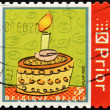 图库照片: BELGIUM - CIRC2006: stamp printed in Belgium shows cake with candle, circ2006