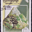 CAMBODIA - CIRCA 1998: A stamp printed in Cambodia shows an emerald, circa 1998 - Stock Photo