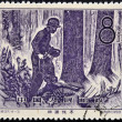 Foto de Stock  : CHIN- CIRC1958: stamp printed in Chindedicated to Forestry, shows Cutting with chainsaw, circ1958