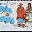 Stock Photo: CUB- CIRC1990: stamp printed in Cubdedicated to Latin Americhistory, shows typical costume and flag of Argentina, circ1990