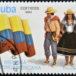 Stock Photo: CUB- CIRC1990: stamp printed in Cubdedicated to Latin Americhistory, shows typical costume and flag of Colombia, circ1990