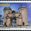 Royalty-Free Stock Photo: SPAIN - CIRCA 2012: A stamp printed in Spain dedicated to arches and monumental gates, shows Puerta de Palmas in Badajoz, circa 2012