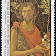Постер, плакат: GUINEA BISSAU CIRCA 1985: a stamp printed in Guinea Bissau shows St John the Evangelist by Botticelli circa 1985