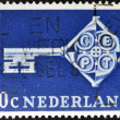 Stock Photo: HOLLAND - CIRCA 1968: A stamp printed in Holland shows a cross-shaped key, and CEPT emblem on the neck, circa 1968