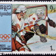 CAMBODIA - CIRCA 1987: A stamp printed in Cambodia shows Canadian team players, ice hockey, circa 1987 — 图库照片