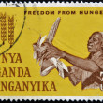 KENYA UGANDA TANGANYIKA - CIRCA 1963: A British stamp printed in Kenya, Uganda and Tanganyika (now Tanzania) dedicated to freedom from hunger, circa 1963 — Stock Photo