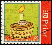 BELGIUM - CIRCA 2006: A stamp printed in Belgium shows cake with a candle, circa 2006 — Foto Stock
