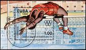 CUBA - CIRCA 1990: A stamp printed in Cuba shows high jump athlete, circa 1990 — Stock Photo