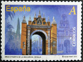 SPAIN - CIRCA 2012: A stamp printed in Spain dedicated to arches and monumental gates, shows Arc or Puerta de la Macarena in Seville, circa 2012 — Stock Photo