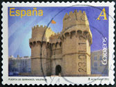 SPAIN - CIRCA 2012: A stamp printed in Spain dedicated to arches and monumental gates, shows Puerta de Serranos in Valencia, circa 2012 — Stock Photo