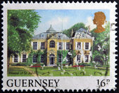 GUERNSEY - CIRCA 2000: A stamp printed in Guernsey shows Hostel of St John, circa 2000 — Stock Photo