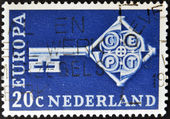 HOLLAND - CIRCA 1968: A stamp printed in Holland shows a cross-shaped key, and CEPT emblem on the neck, circa 1968 — Foto Stock