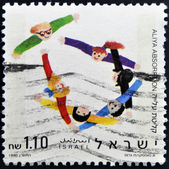 ISRAEL - CIRCA 1990: A stamp printed in Israel dedicated to aliya absorption, circa 1990 — Stock Photo