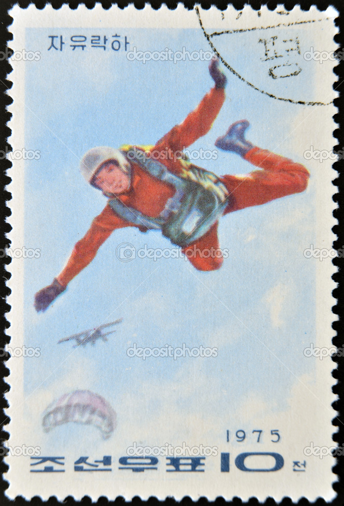 NORTH KOREA - CIRCA 1975: A stamp printed in North Korea shows parachutist, circa 1975  Stock Photo #10209015