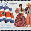 Stock Photo: CUB- CIRC1990: stamp printed in Cubdedicated to Latin Americhistory, shows typical costume and flag of CostRica, circ1990