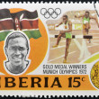 LIBERIA - CIRCA 1973: stamp printed in Liberia shows Gold medal winners in 20th Olympic Games, Kipchoge Keino, Kenya, 3000-meter steeplechase, circa 1973 - Stock Photo