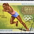 Stock fotografie: MONGOLI- CIRC1968: stamp printed in Mongolia, shows runner, Jesse Owens, circ1968