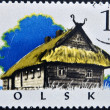 POLAND - CIRCA 1973: A stamp printed in Poland shows typical house, Kurpie-chata, circa 1973 — Stock Photo