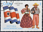 CUBA - CIRCA 1990: A stamp printed in Cuba dedicated to Latin American history, shows typical costume and flag of Costa Rica, circa 1990 — Foto Stock