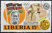 LIBERIA - CIRCA 1973: stamp printed in Liberia shows Gold medal winners in 20th Olympic Games, Kipchoge Keino, Kenya, 3000-meter steeplechase, circa 1973 — Stock Photo