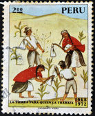 PERU - CIRCA 1972: A stamp printed in Peru shows Indians working the land with the message: the land to the tiller, circa 1972 — Stok fotoğraf