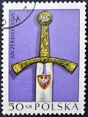 POLAND - CIRCA 1973: A stamp printed in Poland shows handle of sword , circa 1973 — Stok fotoğraf