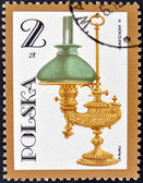POLAND - CIRCA 1982: A stamp printed by Poland shows antique oil lamp, circa 1982 — Stock Photo