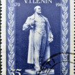图库照片: ROMANIA-CIRC1960: stamp printed in Romanis shows Vladimir Ilyich Lenin, circ1960
