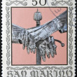 SAN MARINO - CIRCA 1974: A stamp printed in San Marino dedicated to Ancient Weapons from Cesta Museum, shows Gauntlets and Sword Pommel, circa 1974 — Stock Photo