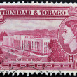 Stock Photo: TRINIDAD AND TOBAGO - CIRC1950: stamp printed in Trinidad shows General Post Office and Treasury, circ1953
