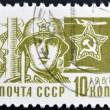 USSR - CIRCA 1966: A stamp printed in Russia showing a Soldier and star emblem, circa 1966. — Stock Photo #10220514