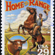 Stock Photo: UNITED STATES OF AMERIC- CIRC1994: Stamp printed in USshows Home on Range culture in AmericOld West, circ1994