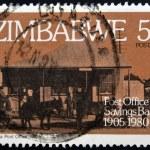 ZIMBABWE - CIRCA 1980: A stamp printed in Zimbabwe shows Gatooma Post Office 1912, circa 1980 — Stock Photo #10221743