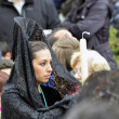 Stock Photo: GRANADA, SPAIN - APRIL 6: Female participant in Easter Procession on April 6, 2012 in Granada, Spain. womcarries traditional head coverage called mantilla
