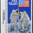Stock Photo: UNITED STATES OF AMERICA - CIRCA 1988: A stamp printed in USA shows Astronauts planting Flag on Moon, 20th Anniversary of First Manned Moon Landing, circa 1988