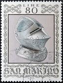 SAN MARINO - CIRCA 1974: A stamp printed in San Marino dedicated to Ancient Weapons from Cesta Museum, shows Sallet Helmet, circa 1974 — Stock Photo