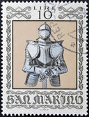 SAN MARINO - CIRCA 1974: A stamp printed in San Marino dedicated to Ancient Weapons from Cesta Museum, shows German Armour, circa 1974 — Foto de Stock