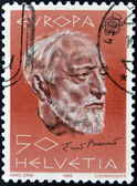 SWITZERLAND - CIRCA 1985: A stamp printed in Switzerland shows Ernest Ansermet, circa 1985 — Stok fotoğraf