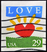 UNITED STATES OF AMERICA - CIRCA 1994: A stamp printed in USA shows Sun in Form of the Heart, Love, circa 1994 — Foto de Stock