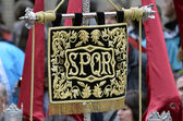 GRANADA, ANDALUSIA, SPAIN - APRIL 6:Banner with the letters SPQR (Senatvs Popvlvsqve Romanvs) in typical procession of Holy Week in April 6, 2012 in Granada, Andalusia, Spain — Stock Photo