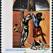 "Foto de Stock  : SPAIN - CIRC1994: stamp printed in Spain shows ""Poetry of America"" by Salvador Dali, circ1994"
