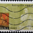 Stock Photo: FRANCE - CIRCA 2007: A stamp printed in France dedicated to ancient Rome, shows Pompeii fresco housing, circa 2007