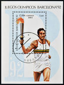 CUBA - CIRCA 1991: A stamp printed in Cuba dedicated to Olympic Games of Barcelona 1992, shows athlete with the Olympic flame, circa 1991 — Stock Photo
