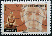 FRANCE - CIRCA 2007: A stamp printed in France dedicated to ancient Egypt, shows sculpture of a seated scribe, circa 2007 — Stock Photo