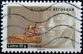 FRANCE - CIRCA 2007: A stamp printed in France dedicated to ancient Etruscans, shows coffin burial of spouses, circa 2007 — Stock Photo