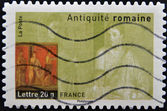 FRANCE - CIRCA 2007: A stamp printed in France dedicated to ancient Rome, shows Pompeii fresco housing, circa 2007 — Stock Photo