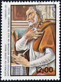 GUINEA BISSAU - CIRCA 1985: a stamp printed in Guinea-Bissau shows St. Augustine in the work room by Botticelli, circa 1985 — Stock Photo