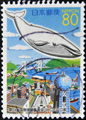 JAPAN - CIRCA 1993: A stamp printed in Japan shows Whale on the city, circa 1993 — Foto Stock