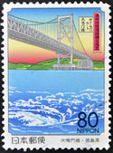 JAPAN - CIRCA 1998: A stamp printed in Japan shows Naruto Bridge, circa 1998 — Stok fotoğraf