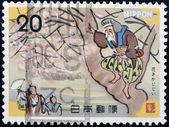 Japón - circa 1973: un sello impreso en japón muestra a hombre en la flor de la edad (hanasakajiisan), circa 1973 — Foto de Stock